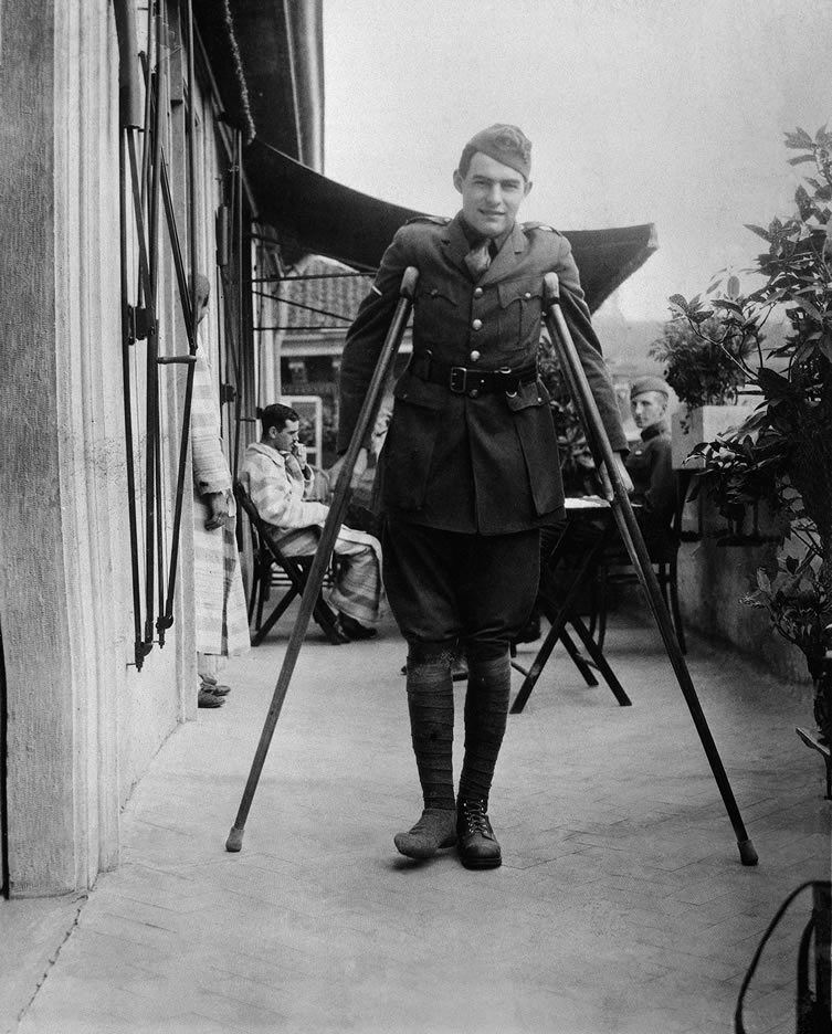 Ernest Hemingway on crutches while recovering in Milan