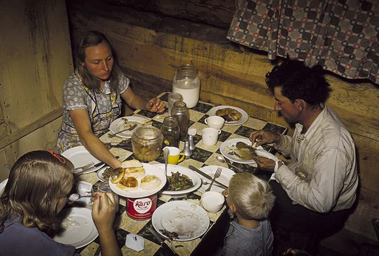 The Faro Caudill Family Eating Dinner in Their Dugout, Pie Town, New Mexico, 1940