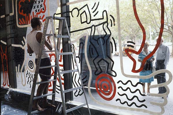 Keith Haring preparing an artwork on the Waterwall at the NGV, 1984