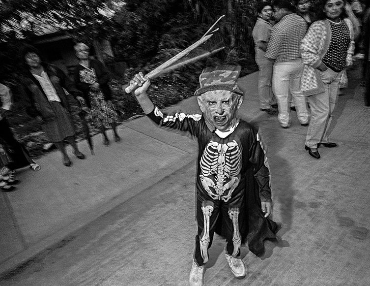 Boy in Skeleton Costume Waving Stick, Etla, 2001