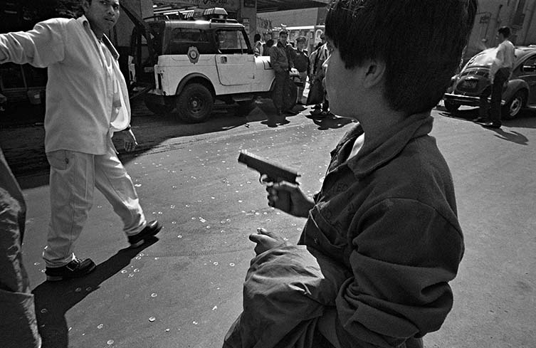 Youth Pointing Gun, Mexico City, 1997