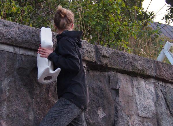 Hanna-Kaarina Heikkilä hiding a City rabbit, Helsinki