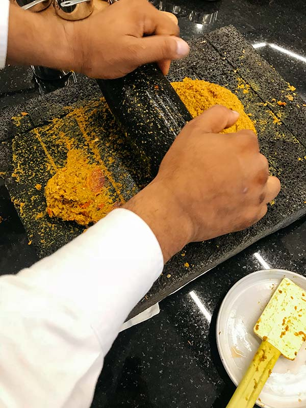 Crafting a typical Mauritian free range chicken curry under the tutelage of executive chef Khader Rehad