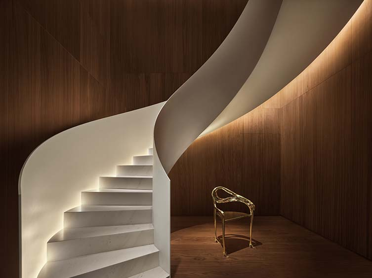Salvador Dali's gold Leda chair at the foot of the spellbinding staircase that accesses the Punch Room.