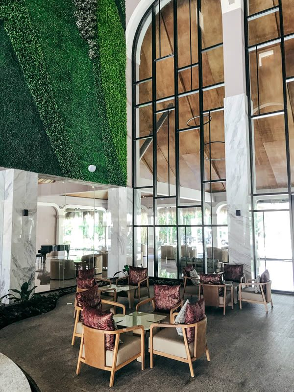 TRS Hotels Riviera Maya: The expansive marble of the TRS's lobby is offset by the lush green of two soaring living walls