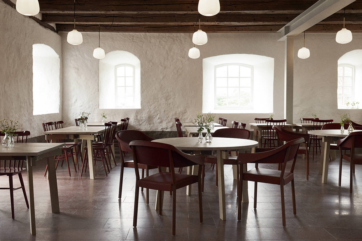 Wanås Restaurant with table from Blå station and chairs from Gärsnäs covered in leather from the Wanås Estate.